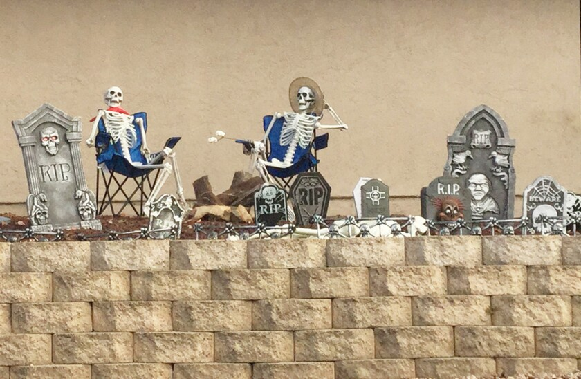 These skeletons were spotted roasting marshmallows amid gravestones in the front yard of a Westwood home on Poblado Way.