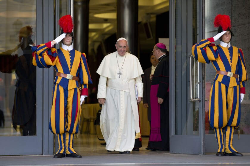 Pope Francis leaves at the end of an afternoon session of a two-week synod on family issues at the Vatican.
