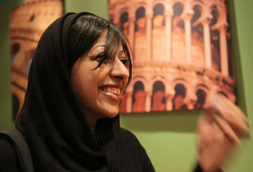 Bahraini activist Zainab al-Khawaja smiles hours after being released from jail at a coffee shop in Abu Saiba, Bahrain, west of the capital of Manama, on Sunday, Feb. 16, 2014. A lawyer for al-Khawaja, she has been released from prison after nearly a year behind bars for multiple convictions including participation in an illegal gathering. (AP Photo/Hasan Jamali)