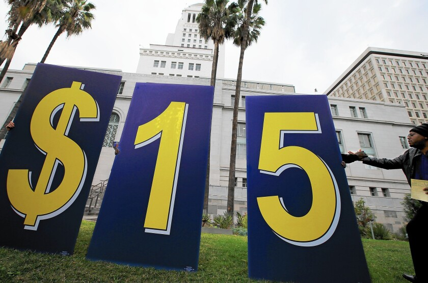 A demonstration outside Los Angeles City Hall in January urges the City Council to increase the minimum wage.