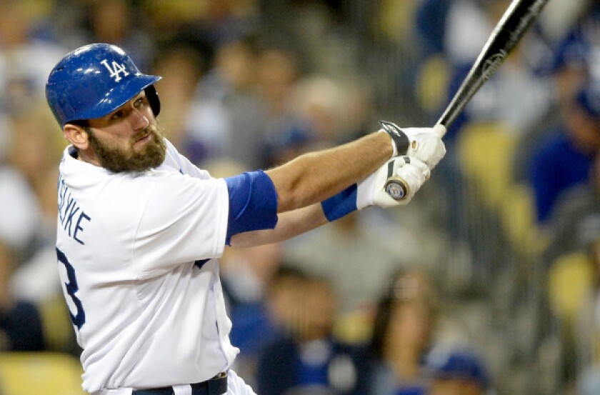 Dodgers left fielder Scott Van Slyke hits a solo home run to tie the score, 1-1, with the Arizona Diamondbacks in the seventh inning Friday night at Dodger Stadium.