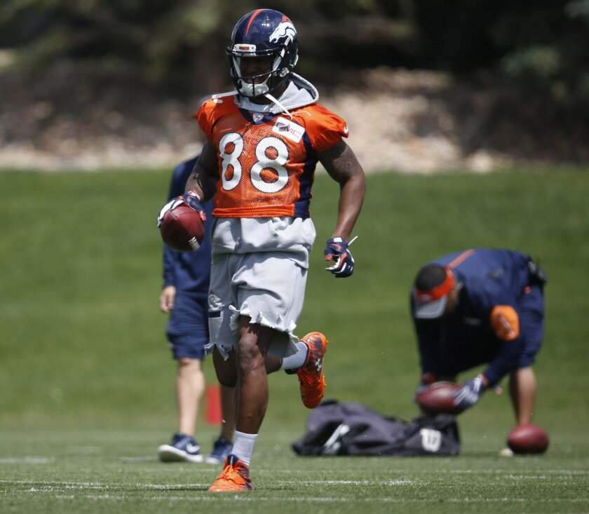 In this Tuesday, May 31, 2016, photograph, Denver Broncos wide receiver Demaryius Thomas finishes a pass route during an NFL football practice at the team's headquarters in Englewood, Colo. Thomas will join his teammates who won Super Bowl 50 in a visit to the White House on Monday, June 6. While t
