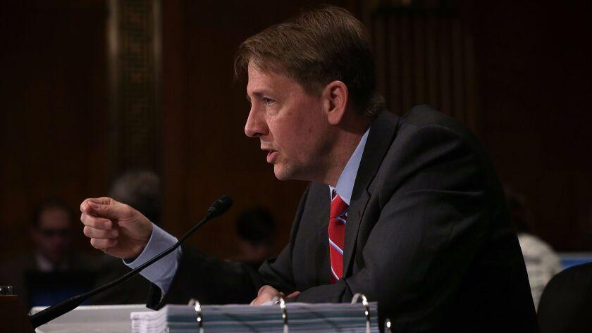 Richard Cordray, director of the Consumer Financial Protection Bureau, testifies during a Senate hearing in 2016.