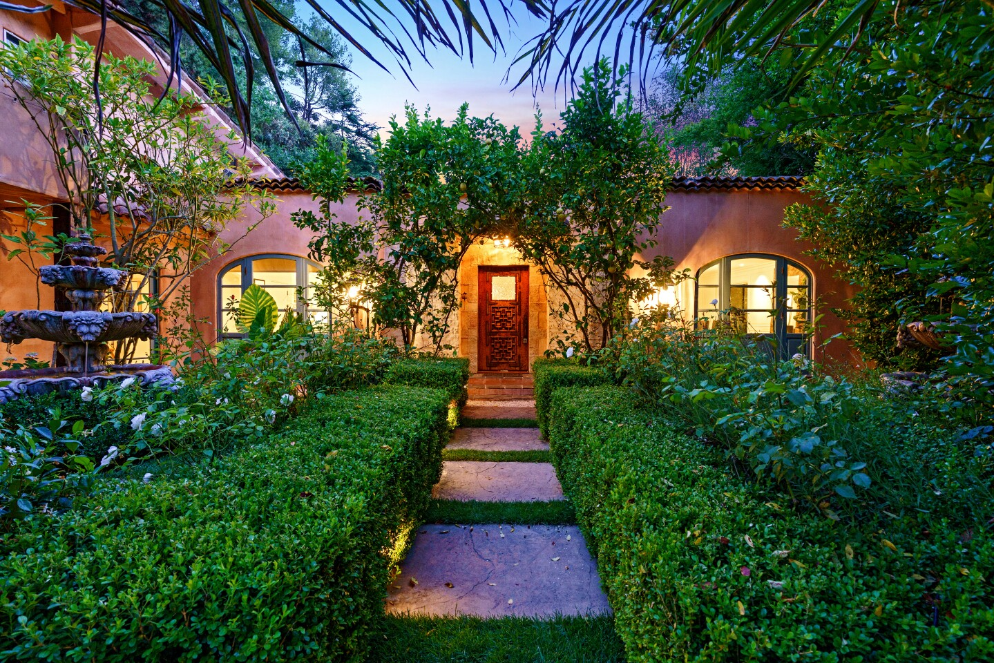The actor and his wife, model-designer Neha Kapur, are asking $3.995 million for their compound, which spans half an acre in Hollywood Hills. The Mediterranean villa-style main house and two guesthouses are on the leafy property. Courtyards, patios and a swimming pool with a separate pool house fill out the grounds.