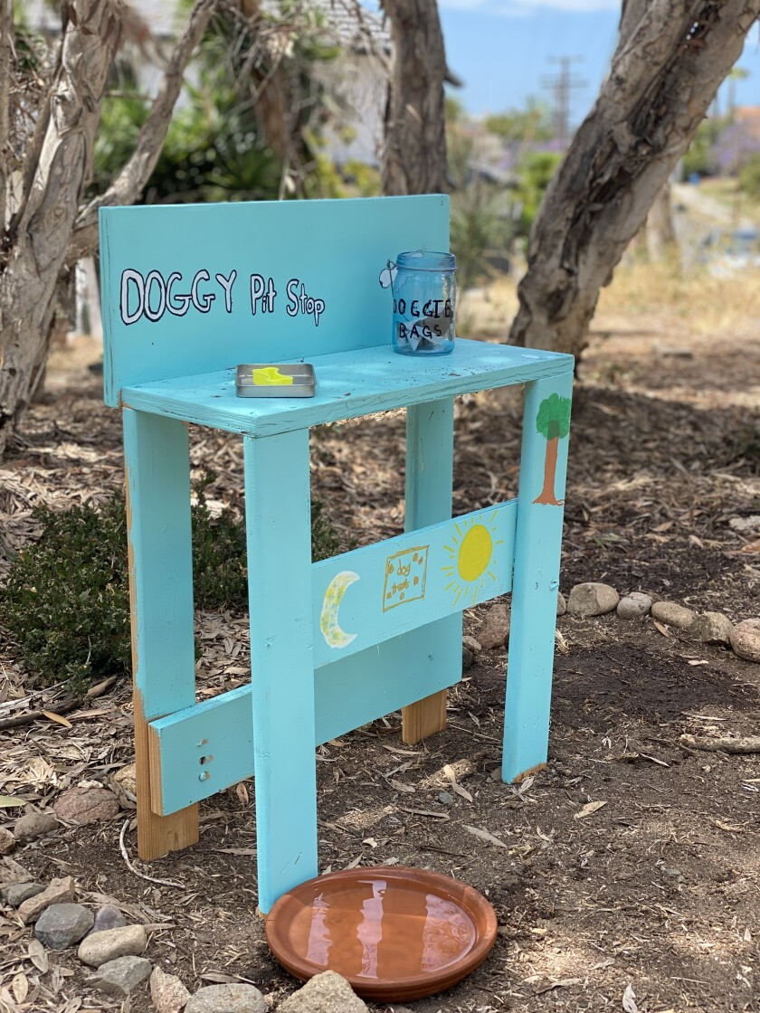 """A """"Doggy Pit Stop"""" sits on the La Jolla Bike Path, created to provide snacks and more to passing dogs."""
