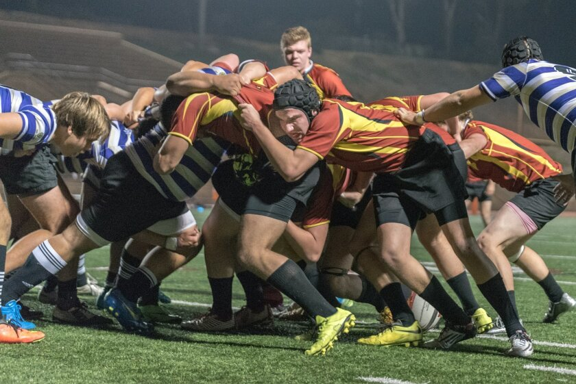 Torrey Pines Flanker Jackson Baere (scrum cap) helps push in the scrum against St. Augustine. The Torrey Pines Varsity Rugby team beat Saints, 28-7, for its fifth win in a row. Photo by Denise Cavanagh