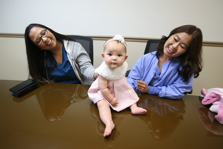 la-two-nurses-bring-baby-josephine-into-the-wo-001