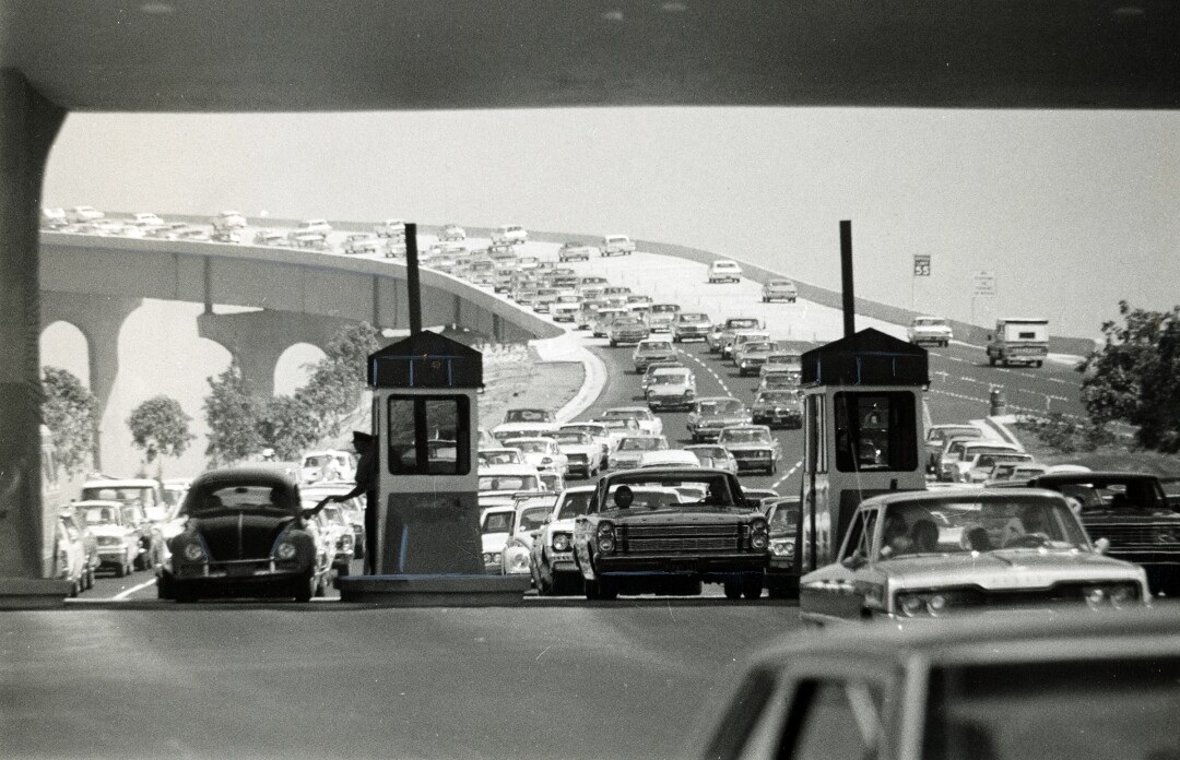 The day after the San Diego-Coronado Bridge was dedicated, cars lined up on both sides to be among the first to drive across it. More than 3,000 did so in the first hour, some 40,000 on the first day.