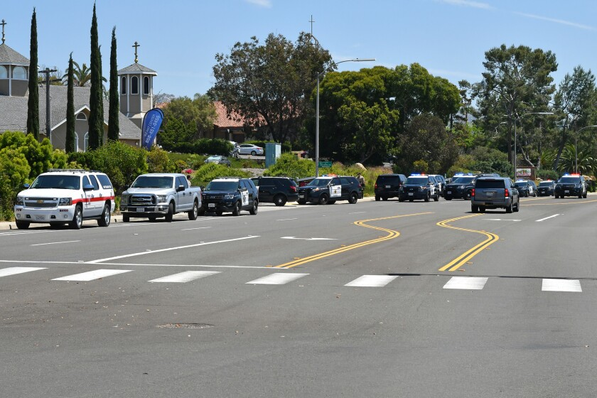 Law enforcement vehicles lined Espola Road near the shooting scene Saturday afternoon.