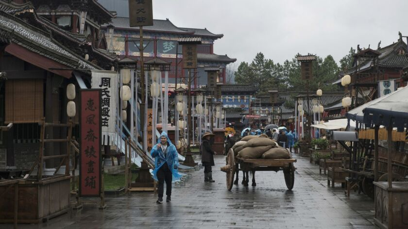 """Extras on set shooting """"The Story of Ming Lan"""" at Hengdian."""