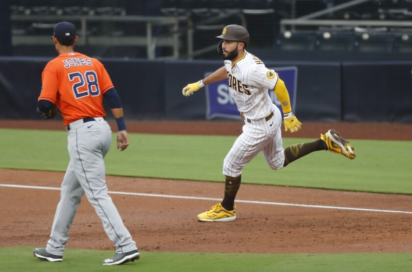 Eric Hosmer runs to second base after hitting a double against the Houston Astros last month.