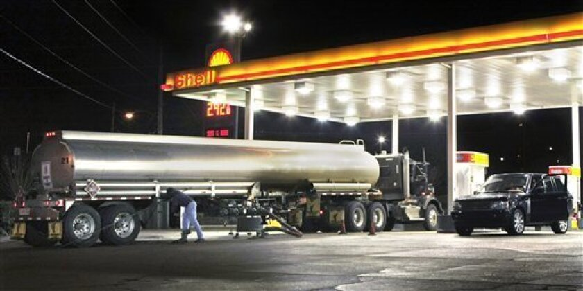 FILE - In this file photo taken Nov. 20, 2009, a tanker truck makes a fuel delivery at a Little Rock, Ark., gas station. A nine-month rally in oil prices could be faltering as a gradual sell-off that began in late October gains momentum.(AP Photo/Danny Johnston, file)