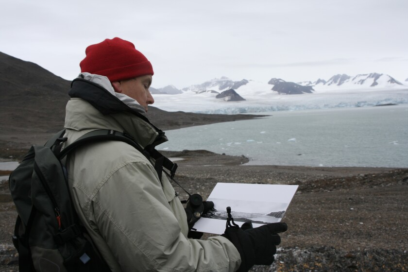 Prince Albert II is seen in 2005 in Svalbard, Norway, comparing the situation there with how it was in 1906, when his great-great-grandfather Prince Albert I visited.