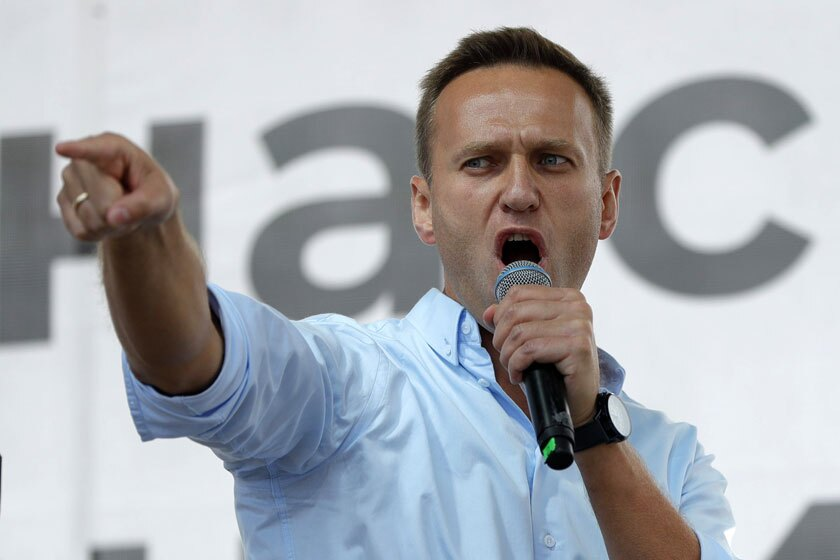 Activist Alexei Navalny, shown speaking at a public event, fell ill on Aug. 20 on a domestic flight in Russia.