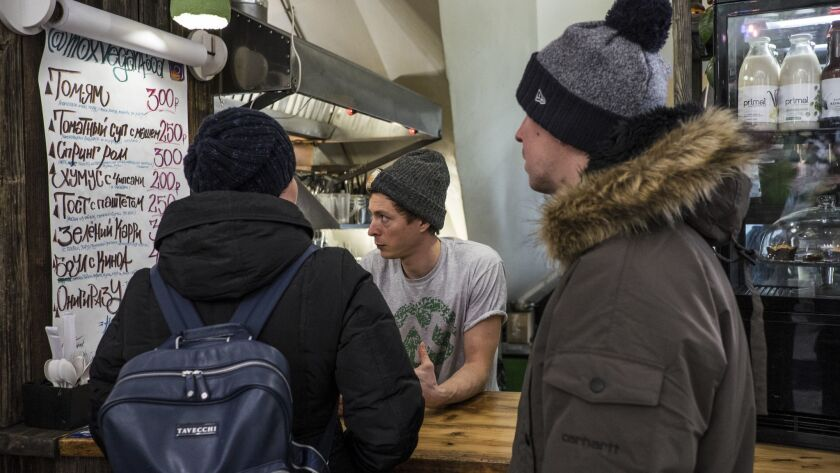 Karibu Kombucha founder Ilya Devedzhian talks with some of his customers at Danilovsky Market in Moscow.