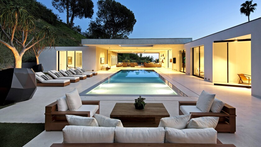 This modern showplace in Beverly Hills is on the site of what was once comic Morey Amsterdam's longtime home.
