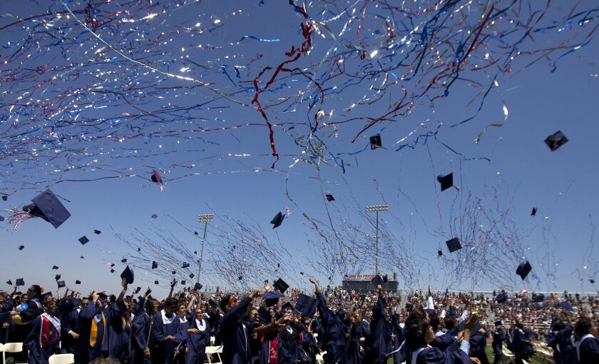 Graduates throw their mortarboards in the air after receiving their diplomas during Heritage High School's 2012 graduation ceremony in Menifee.