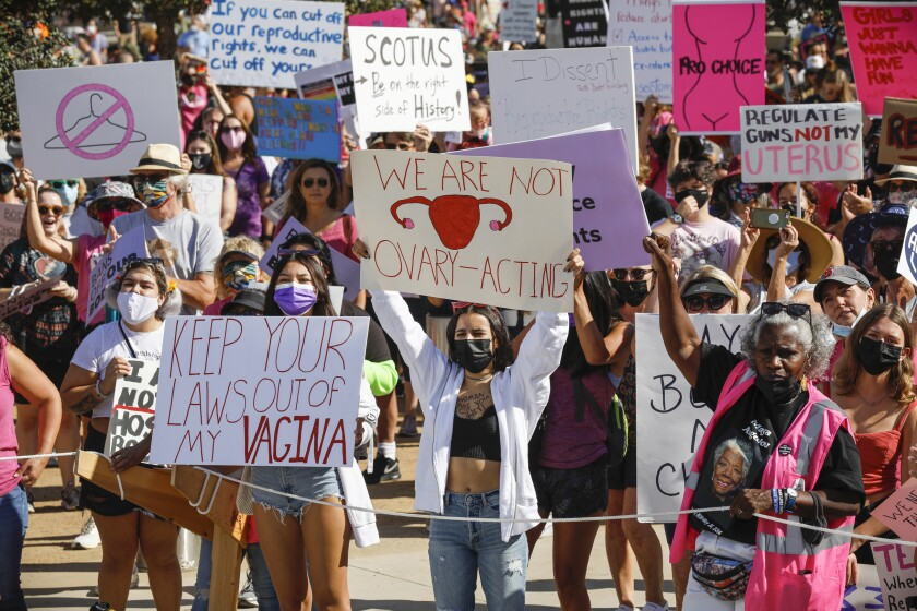 A crowd holds signs during a reproductive rights rally