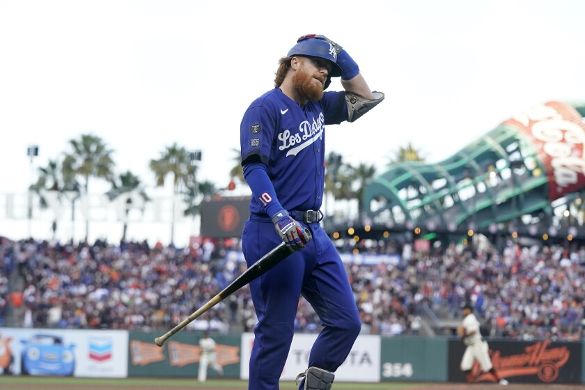 Dodgers third baseman Justin Turner walks to the dugout after striking out.