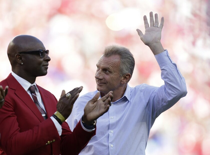 Hall of famers Jerry Rice and Joe Montana are introduced before an NFL football game between the San Francisco 49ers and the Chicago Bears in Santa Clara, Calif., Sunday, Sept. 14, 2014. (AP Photo/Marcio Jose Sanchez)
