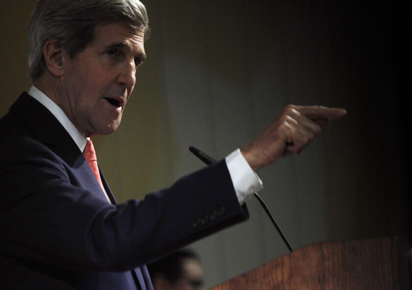 Secretary of State John F. Kerry addresses a news conference Sunday after the a session of nuclear talks with Iran concluded in Geneva.