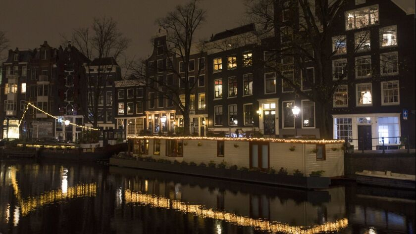 Prinsengracht canal is seen at night in Amsterdam, Netherlands, Wednesday, Nov. 21, 2018. (AP Photo/