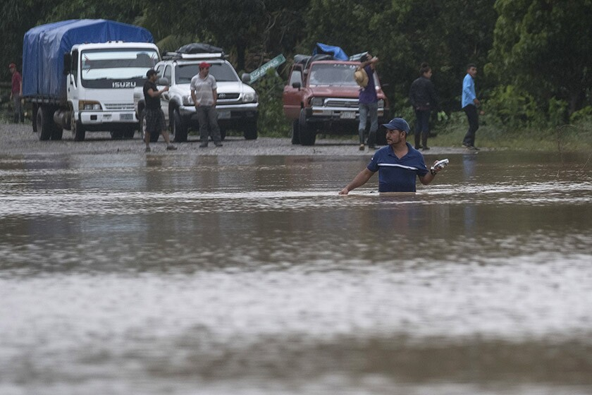 A man wades through floodwaters in Okonwas, Nicaragua, on Wednesday after Hurricane Eta passed through.