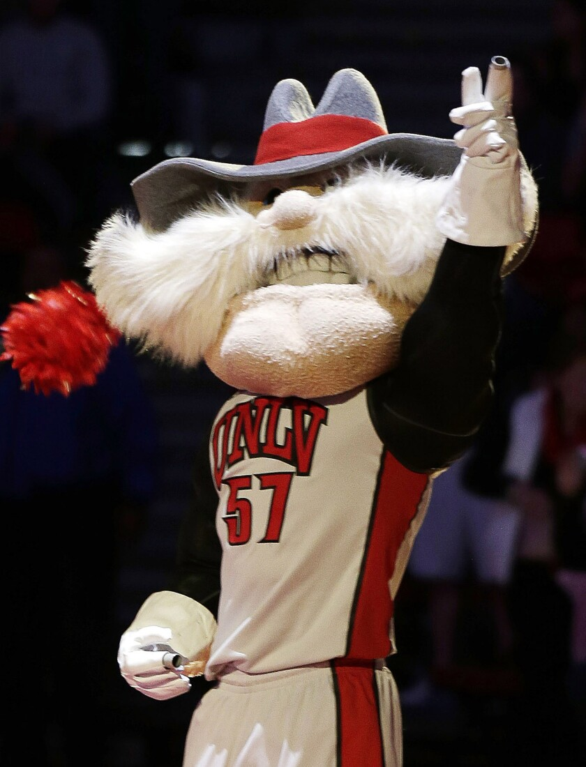 The University of Nevada Las Vegas mascot, Hey Reb! (exclamation mark included), warms up the crowd before a basketball game.
