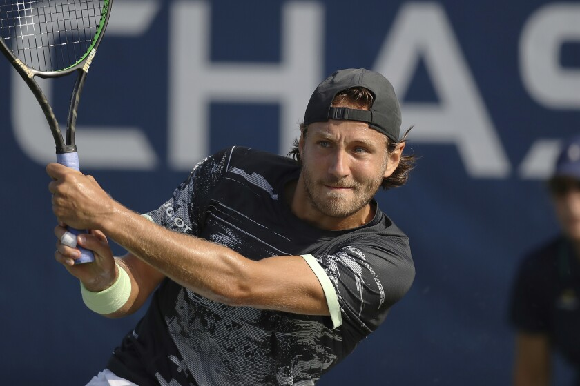 FILE - In this Aug. 26, 2019, file photo, Lucas Pouille, of France, returns a shot to Philipp Kohlschreiber, of Germany, during the first round of the U.S. Open tennis tournament in New York. Former top-10 tennis pro Lucas Pouille will have surgery on his right elbow and miss the return of sanctioned tennis — if the tours do return in August from their pandemic-forced hiatus. The 26-year-old Frenchman said Tuesday, July 14, 2020, on Twitter that he would have the operation in Paris this month. (AP Photo/Steve Luciano, File)