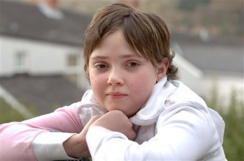 This April 12, 2006, picture shows Hannah Clark, of Cardiff, Wales, who has made a full recovery after being given an extra heart at the age of two. Hannah had a donor heart grafted onto her own after suffering heart failure as a baby. After 10 years with two hearts, Hannah Clark's heart did what m