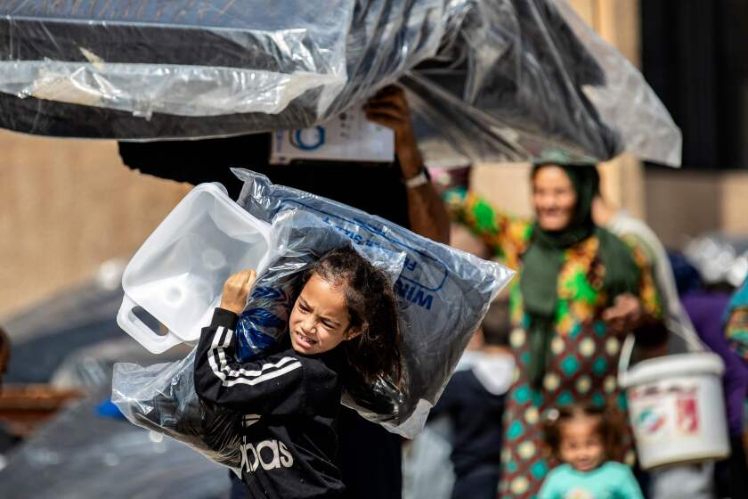 Syrian refugees receive humanitarian aid in Tal Tamr in Hasakeh province.