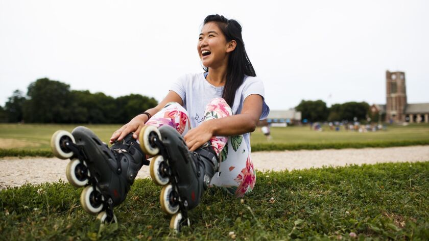 Yanise Ho, 23, poses for a portrait near the Waveland Park softball fields Saturday July 28, 2018 in
