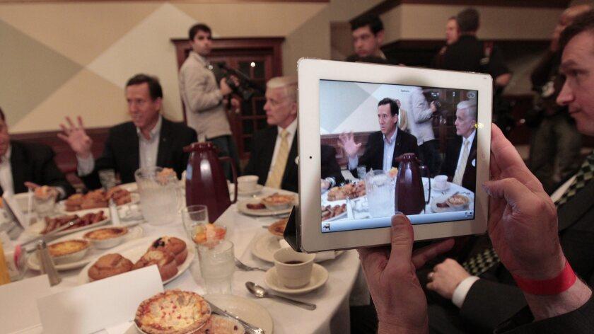 Taking a photo of Rick Santorum on an Apple iPad 2