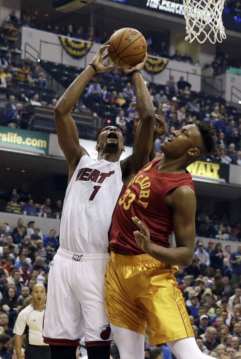 Miami Heat forward Chris Bosh, left, is fouled by Indiana Pacers forward Myles Turner during the first half of an NBA basketball game in Indianapolis, Friday, Nov. 6, 2015. (AP Photo/AJ Mast)