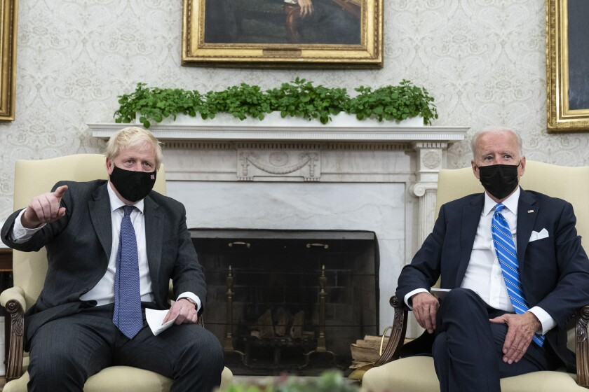 President Joe Biden, right, listens as British Prime Minister Boris Johnson speaks during a meeting in the Oval Office of the White House, Tuesday, Sept. 21, 2021, in Washington. (AP Photo/Alex Brandon)