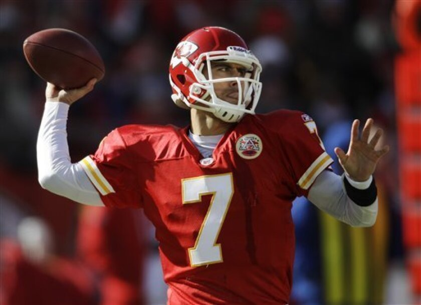 Kansas City Chiefs quarterback Matt Cassel (7) passes to a teammate during the first half of an NFL football game against the Denver Broncos at Arrowhead Stadium in Kansas City, Mo., Sunday, Dec. 5, 2010. (AP Photo/Orlin Wagner)