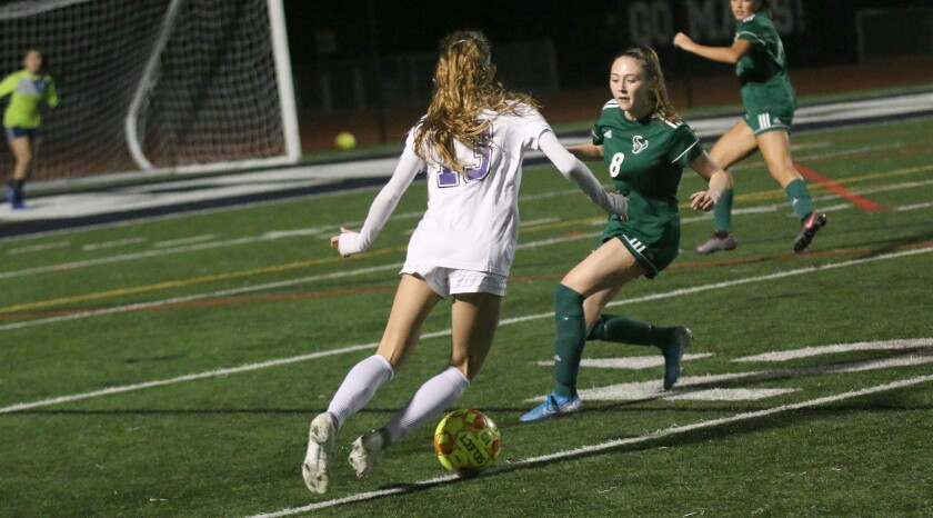 Junior Paige Hays (#8), marking Carlsbad's Lexi Wright, was part of a big LCC defensive effort.