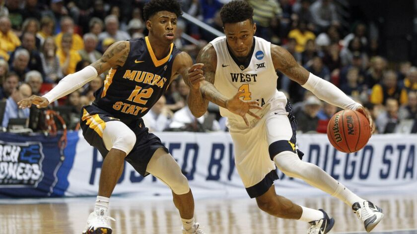 SAN DIEGO, March 16, 2018 | West Virginia's Daxter Miles Jr. drives toward the basket while Murray