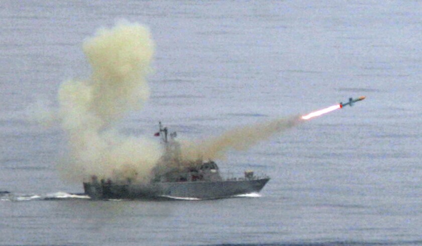 "FILE - In this May 16, 2007, file photo, a Taiwanese navy frigate launches a ""Harpoon"" surface-to-surface missile during the second day of the annual Hankuang military exercises off Ilan, central eastern coast of Taiwan. The State Department says it has notified Congress of plans for a $2.37 billion sale of Harpoon attack missiles to Taiwan, a move likely to anger China. The announcement on Oct. 26, 2020, came just hours after China said it will sanction Boeing Co.'s defense unit, Lockheed Martin Corp. and other U.S. military contractors for supplying weapons to Taiwan.(AP Photo/Wally Santana, File)"