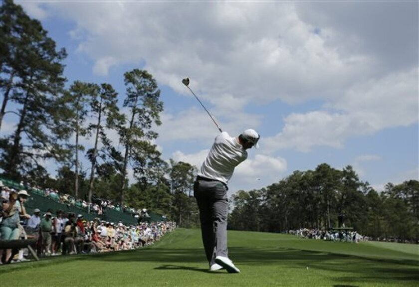 Justin Rose, of England, tees off on the 14th hole during a practice round for the Masters golf tournament Monday, April 8, 2013, in Augusta, Ga. (AP Photo/Matt Slocum)