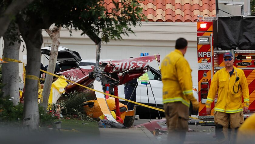 Three people were killed when a helicopter crashed in a Newport Beach neighborhood Tuesday, Jan. 30, 2018.