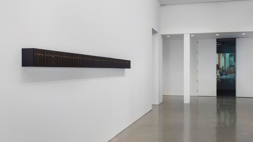 An installation by Theaster Gates made with old copies of Jet magazine, whose spines are covered in poetry.