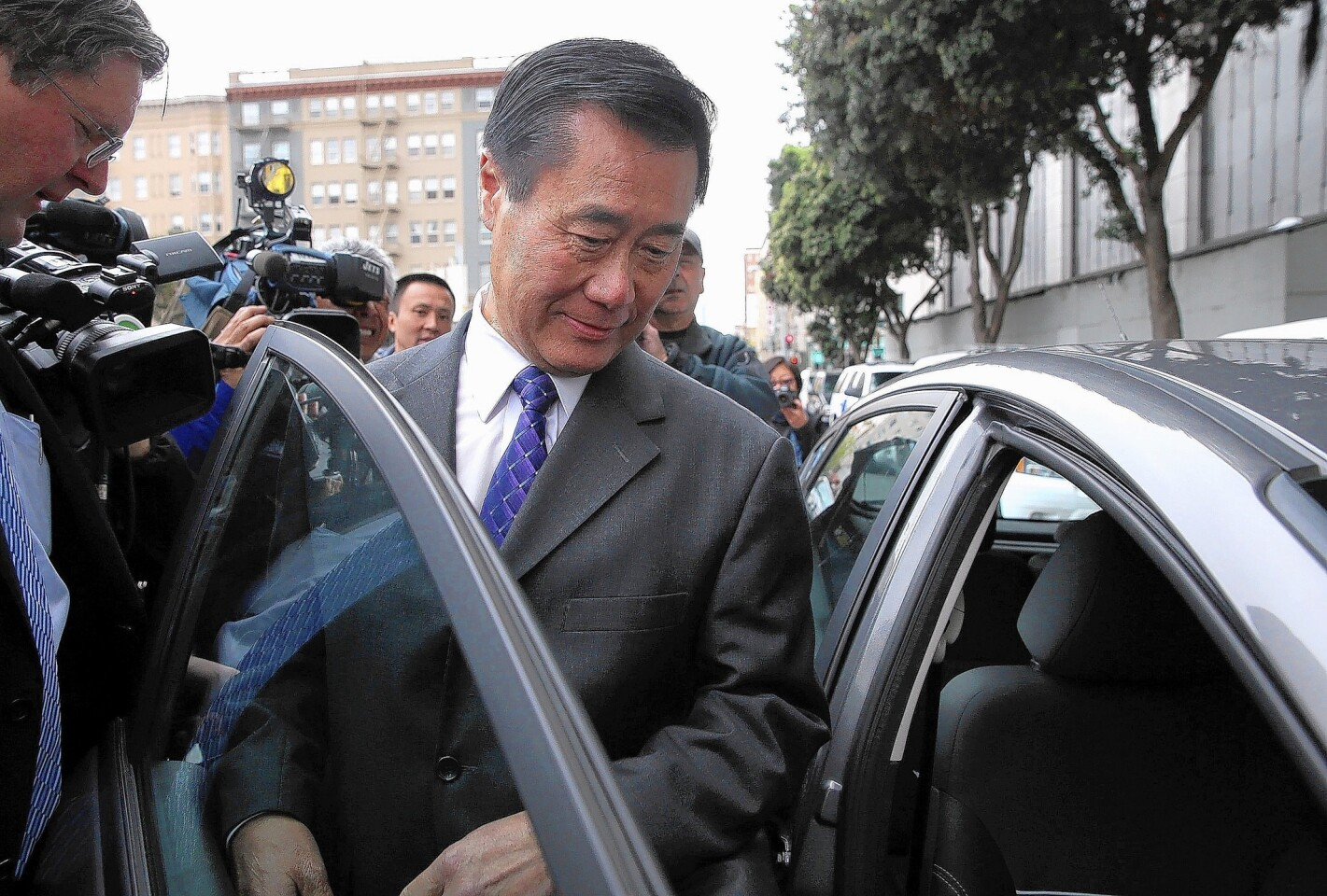 State Sen. Leland Yee leaves the Federal Building in March after a court appearance. Yee was arrested by FBI agents on charges of corruption and conspiring to illegally traffic firearms.