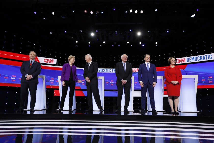 FILE - In this Tuesday, Jan. 14, 2020, file photo, from left, Democratic presidential candidates businessman Tom Steyer, Sen. Elizabeth Warren, former Vice President Joe Biden, Sen. Bernie Sanders, former South Bend Mayor Pete Buttigieg and Sen. Amy Klobuchar stand on stage before a Democratic presidential primary debate hosted by CNN and the Des Moines Register in Des Moines, Iowa. The next Democratic debate is scheduled for Friday, Feb. 7, in New Hampshire. (AP Photo/Charlie Neibergall, File)