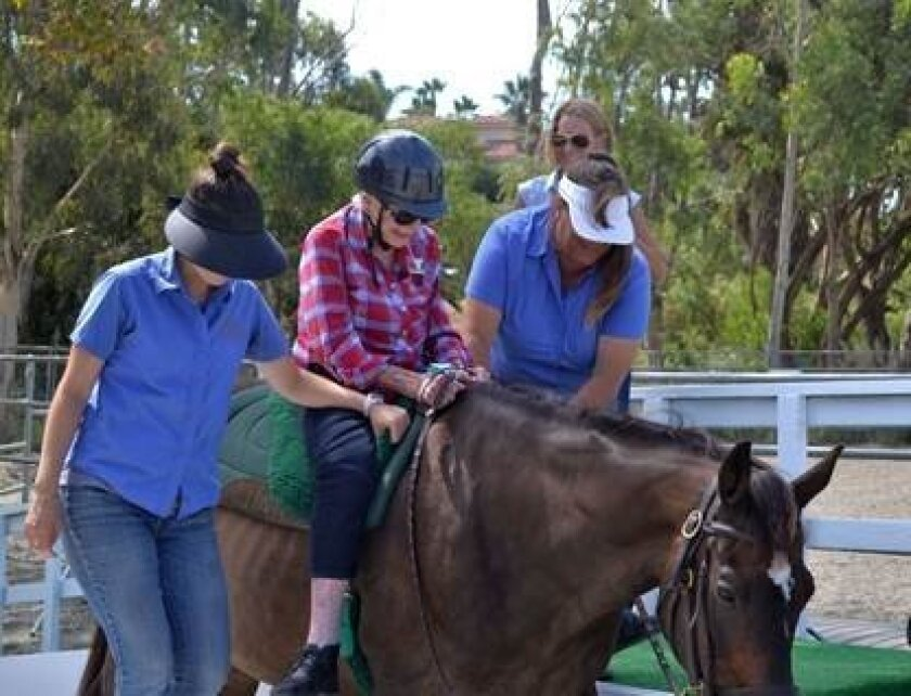 Helen Downey, 97, gets her wish to ride a horse at the Helen Woodward Animal Center.