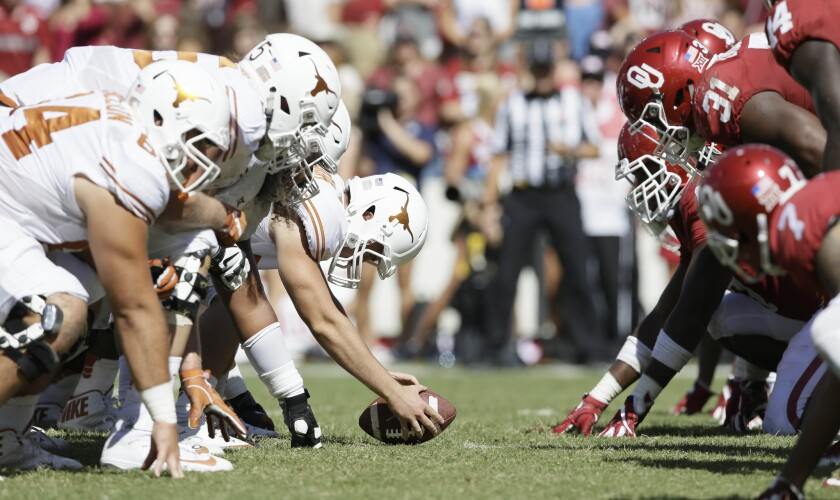 Oklahoma and Texas line up for play during the second half of the Red River Rivalry in Dallas.