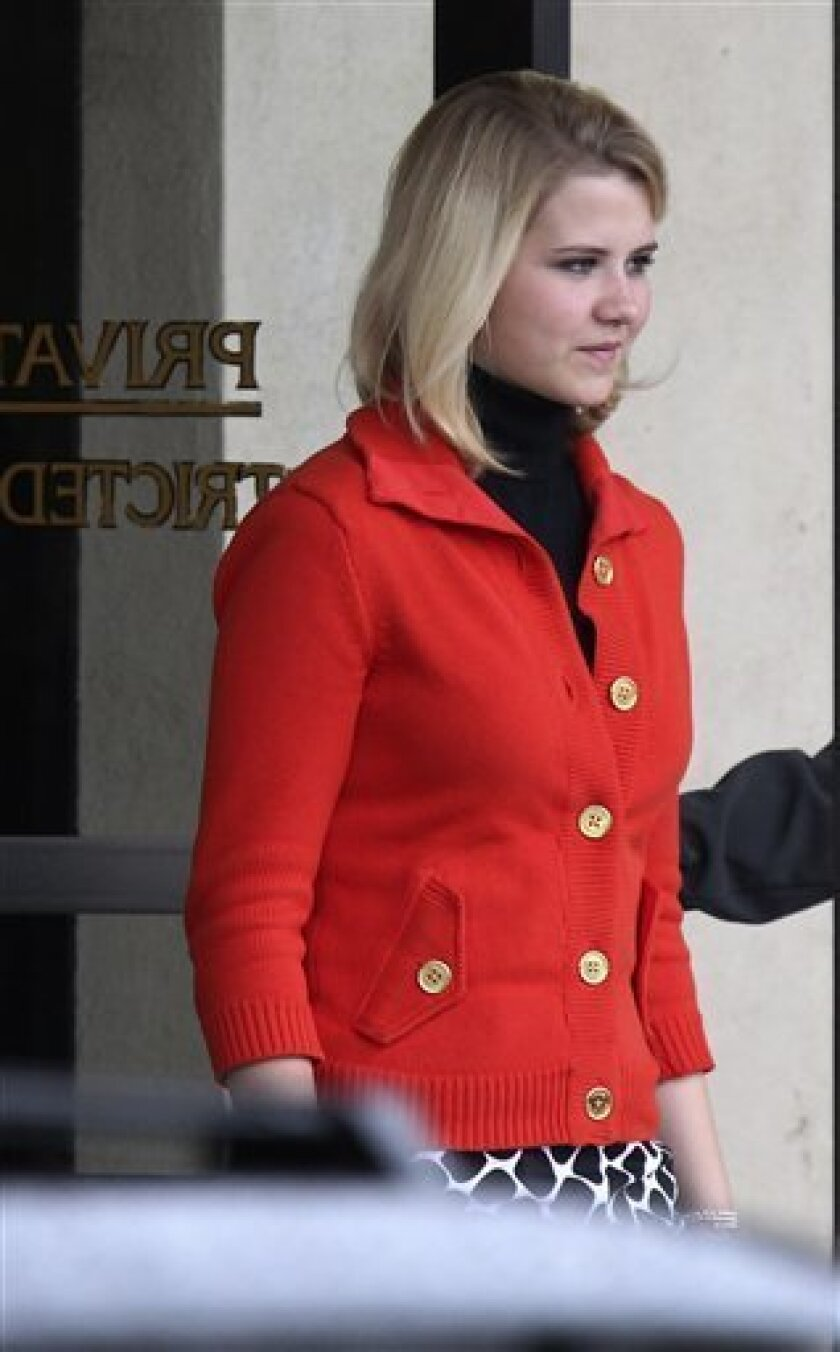 Elizabeth Smart leaves the Frank E. Moss Federal Courthouse Monday, Nov. 8, 2010, in Salt Lake City. Elizabeth Smart took the stand after her mother and younger sister testified. Opening arguments in the Brian David Mitchell trial relating to the kidnapping of Elizabeth Smart in 2002 resumed in Salt Lake City's U.S. District Court Monday after a three-judge panel of the Federal Appeals Court stopped the trial last Thursday in a motion to have it moved out of Utah. (AP Photo/Steve C. Wilson)