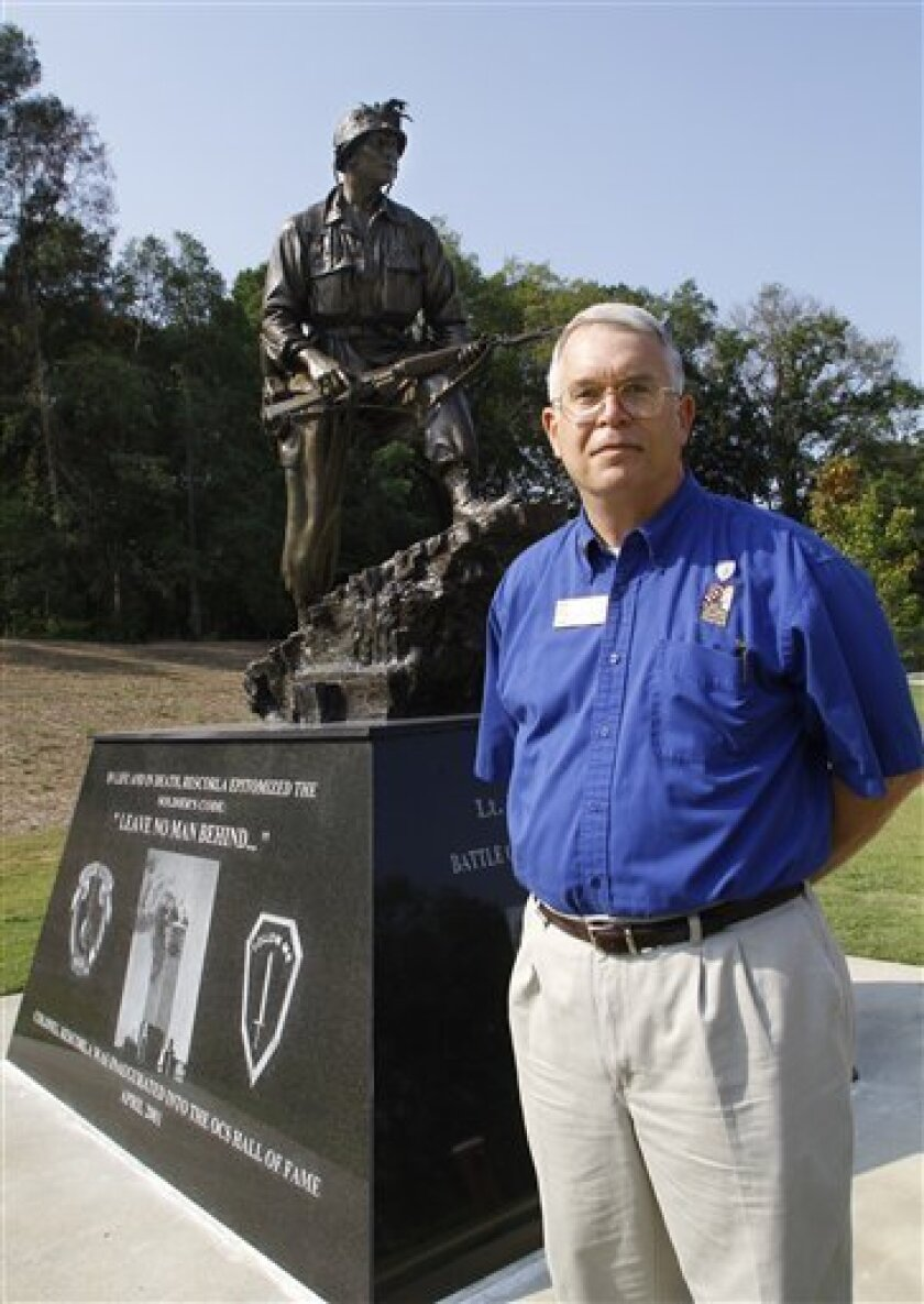 Retired Col. John M. House stands near the memorial to retired Col. Rick Rescorla along the Walk of Honor at the National Infantry Museum and Soldier Center in Columbus, Ga., outside the gates to the Fort Benning Army installation on Wednesday, Aug. 24, 2011. Rescorla, who fought in the Battle of Ia Drang in Vietnam (1965), was killed in the World Trade Center attack after leading the evacuation of nearly 3,000 people from the south tower. House tells the story of Rescorla as he leads tours through the museum. (AP Photo/Robin Trimarchi)