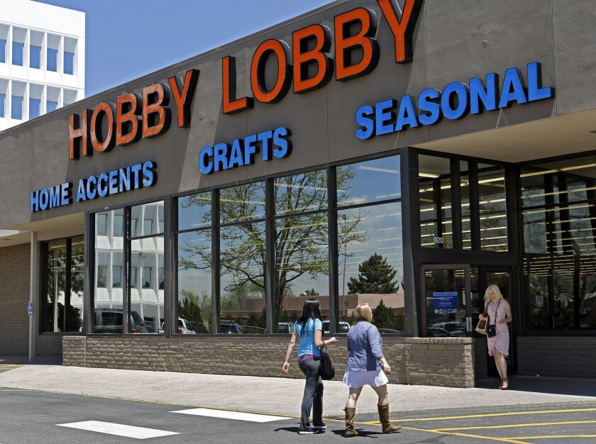 FILE - In this May 22, 2013, customers enter and exit a Hobby Lobby store in Denver. The Obama administration and its opponents are renewing the Supreme Court battle over President Barack Obama's health care law in a case that pits the religious rights of employers against the rights of women to th