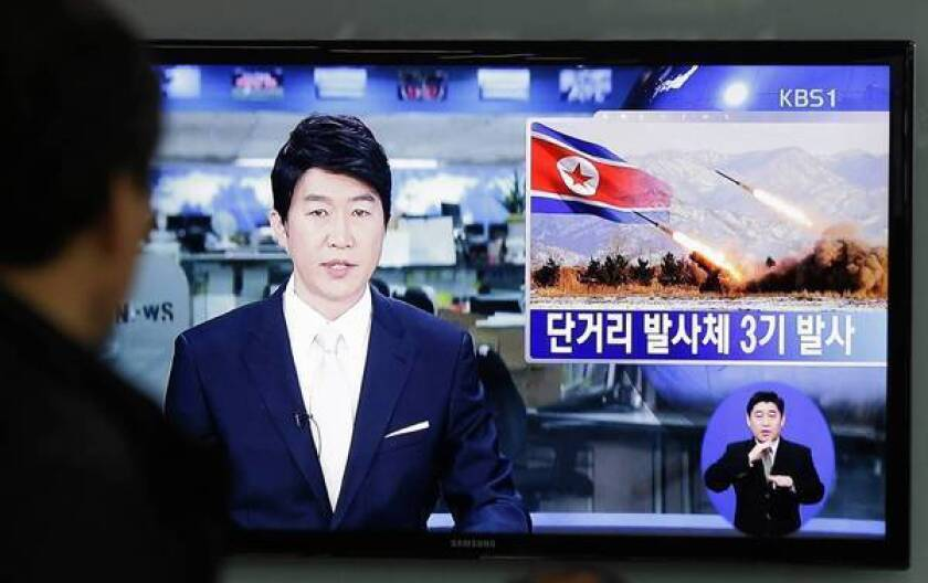 A TV news report in Seoul describes North Korea's launch of three short-range missiles, which a South Korean official said fell into the sea.